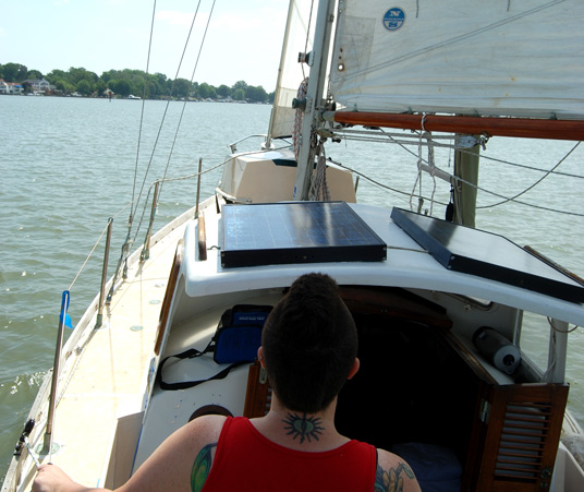 Dena at the helm of S/V S.N. Nomad before the knock down...