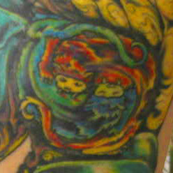 Closeup of the intertwined critters of my tattoo