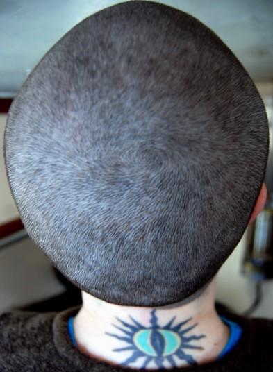 Tattoo'ed baldie