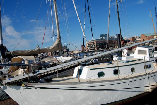 The mast is back on the boat but laying on the foredeck and the dodger.